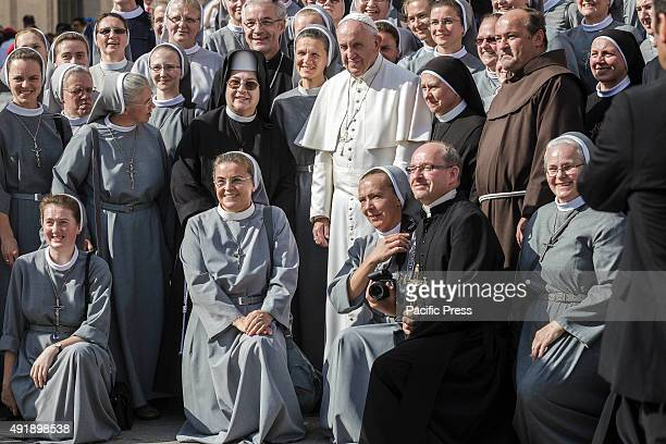 Pope Francis poses for a photo during his weekly General Audience in St Peters Square in Vatican City The first of three Wednesday Audiences...