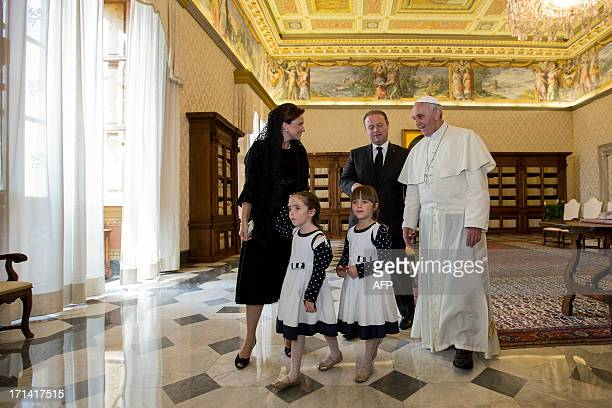 Pope Francis poses for a photo with Malta's Prime Minister Joseph Muscat Muscat's wife Michelle and their two daughters during a private audience in...