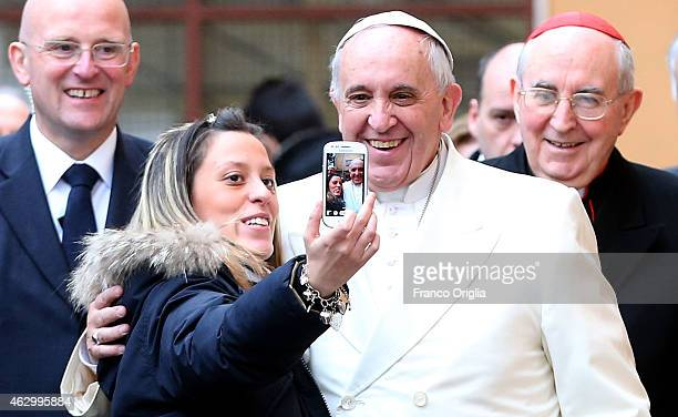 Pope Francis poses for a selfie with a the faithful as he pays a visit to the Roman parish of St Michael the Archangel in Pietralata on February 8...