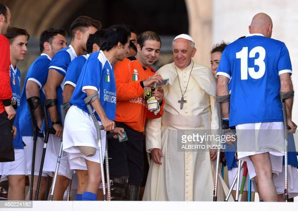 Pope Francis poses for a selfie with members of the Italian amputee football team during the Italian Catholic Sports Centre 70th anniversary...