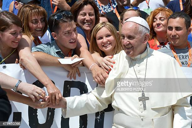 Pope Francis poses with members of the Italian social Cooperative PARS during his weekly general audience at St Peter's square on June 17 2015 at the...