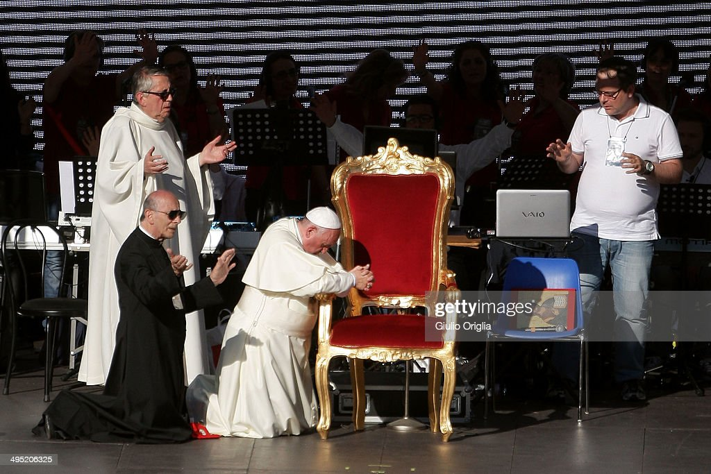 <a gi-track='captionPersonalityLinkClicked' href=/galleries/search?phrase=Pope+Francis&family=editorial&specificpeople=2499404 ng-click='$event.stopPropagation()'>Pope Francis</a> prays as he meets the Movement of the Holy Spirit Renewal at the Olympic Stadium on June 1, 2014 in Rome, Italy. It is the first ever papal visit to a stadium in the Italian capital. This celebration of faith, organised by the Renewal in the Spirit, has been attended by representatives of more than fifty countries and has involved moments of prayer, music and an address by the Holy Father.