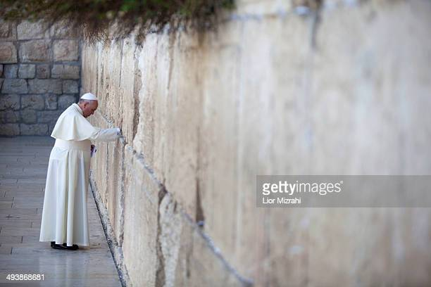 Pope Francis prays by the Western Wall on May 26 2014 in Jerusalem Israel Pope Francis arrived in Israel on Sunday afternoon a day after landing in...