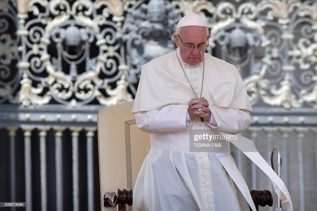 Pope Francis prays during an audience as part of the Jubilee Year of Mercy on April 30, 2016 at St Peter's square in Vatican.