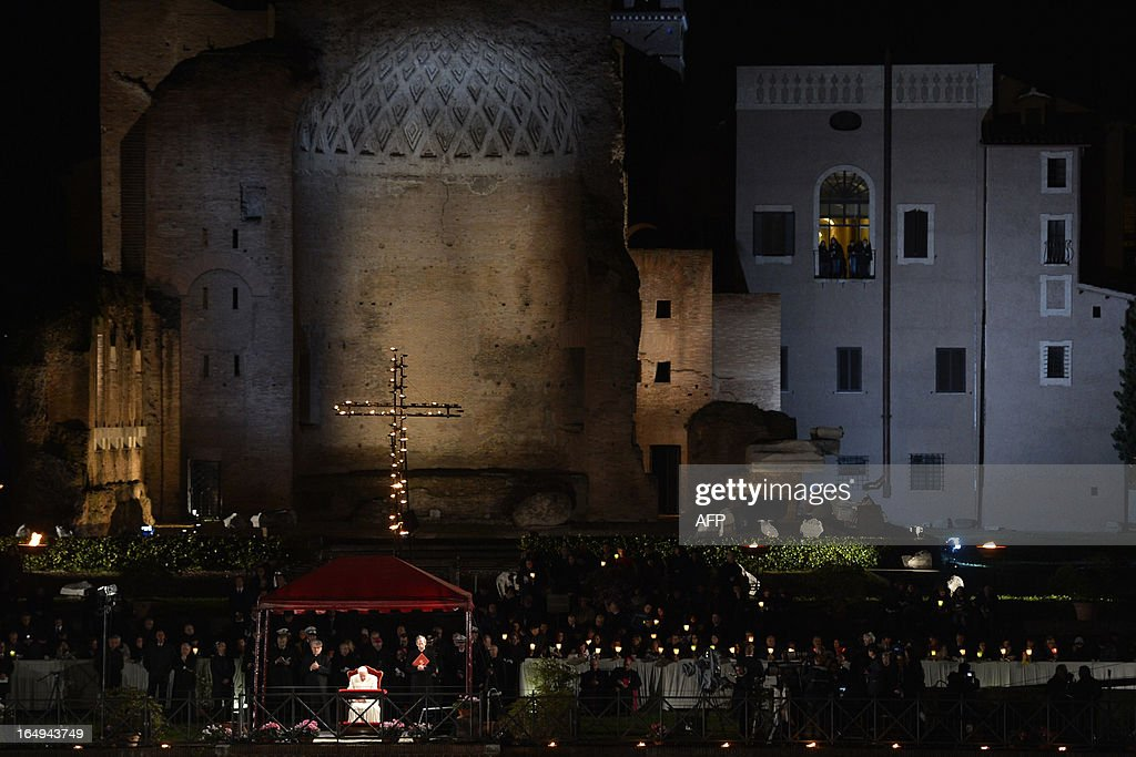 Pope Francis prays during the Way of the Cross on Good Friday on March 29, 2013 in Rome. Pope Francis presided over his first Good Friday which will culminate in a torch-lit procession at Rome's Colosseum and prayers for peace in a Middle East 'torn apart by injustice and conflicts'. AFP PHOTO / ALBERTO PIZZOLI