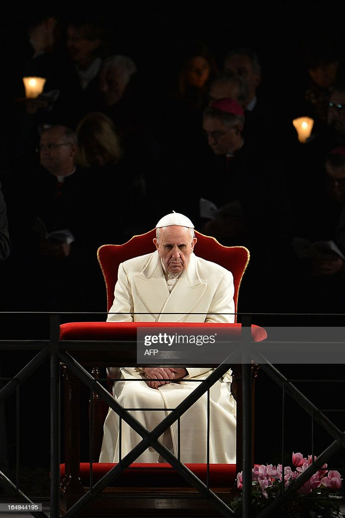 Pope Francis prays during the Way of the Cross on Good Friday on March 29, 2013 at the Colosseum in Rome. Pope Francis presided over his first Good Friday which will culminate in a torch-lit procession at Rome's Colosseum and prayers for peace in a Middle East 'torn apart by injustice and conflicts'. AFP PHOTO / ALBERTO PIZZOLI