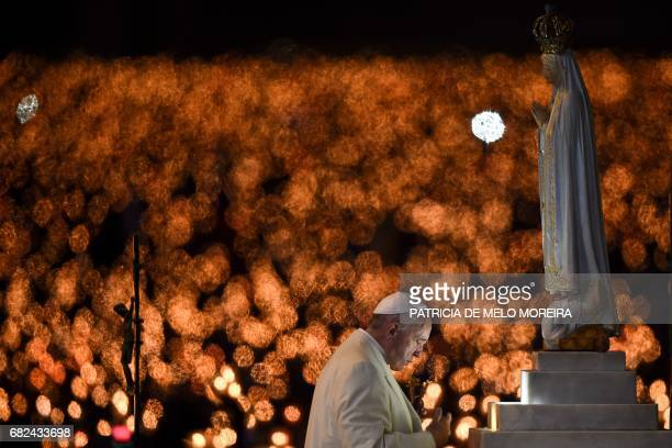 Pope Francis prays in front of a figure representing Our Lady of Fatima during his visit to the Chapel of the Apparitions at the Fatima shrine in...