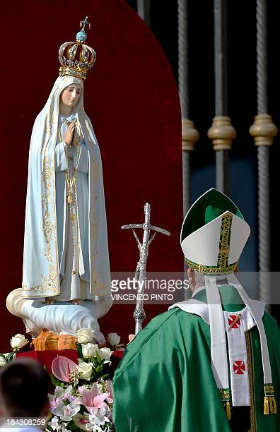 Pope Francis prays in front of the statue of Our Lady of Fatima in Saint Peter's square on October 13 to celebrate a mass as part of the Marian Day...