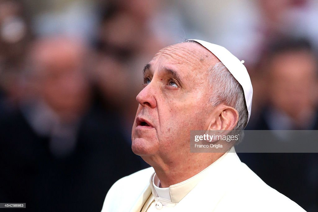 Pope Francis prays in front of the statue of the Immaculate Conceptionon at Spanish Steps December 8 2013 in Rome Italy Following a tradition laid...