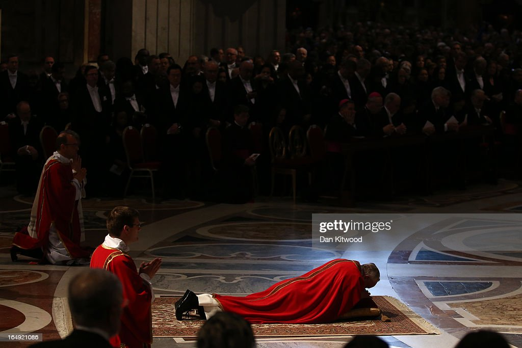 Pope Francis prays on the floor as he presides over a Papal Mass with the Celebration of the Lord's Passion inside St Peter's Basilica on March 29, 2013 in Vatican City, Vatican. Pope Francis is taking part in his first holy week as pontiff and will later today preside over the Way Of the Cross procession at the Colosseum in Rome.