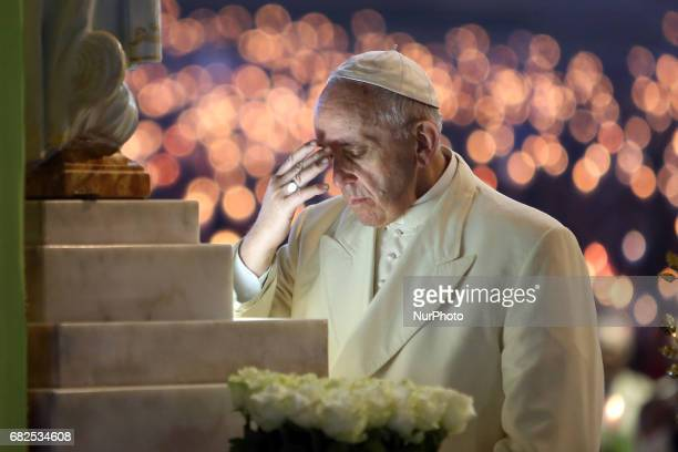 Pope Francis prays to Our Lady of Fatima at Apparitions Chapel before the traditional candle procession at Fatima's Sanctuary Leiria Portugal 12 May...