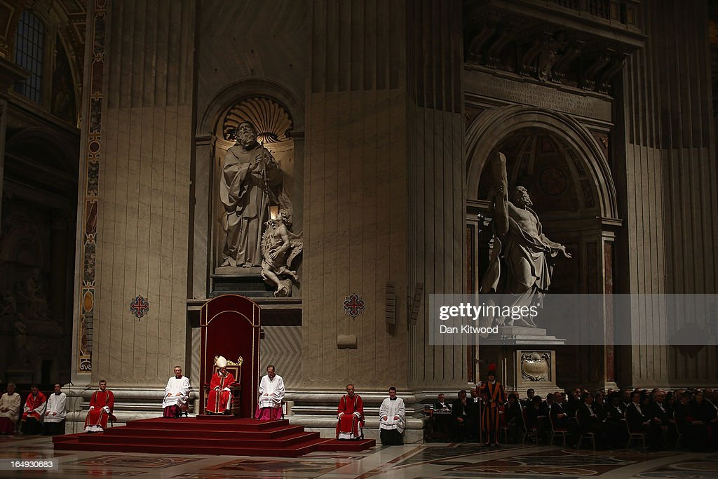 <a gi-track='captionPersonalityLinkClicked' href=/galleries/search?phrase=Pope+Francis&family=editorial&specificpeople=2499404 ng-click='$event.stopPropagation()'>Pope Francis</a> presides over a Papal Mass with the Celebration of the Lord's Passion inside St Peter's Basilica on March 29, 2013 in Vatican City, Vatican. <a gi-track='captionPersonalityLinkClicked' href=/galleries/search?phrase=Pope+Francis&family=editorial&specificpeople=2499404 ng-click='$event.stopPropagation()'>Pope Francis</a> is taking part in his first holy week as pontiff and will later today preside over the Way Of the Cross procession at the Colosseum in Rome.