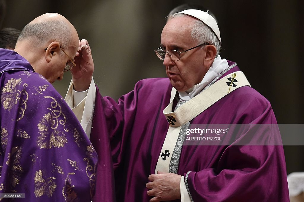 Pope Francis (R) puts ashes on the head of Cardinal Bertone during the Ash Wednesday mass opening Lent, the forty-day period of abstinence and deprivation for Christians, before Holy Week and Easter, on February 10, 2016 in Vatican. / AFP / ALBERTO PIZZOLI