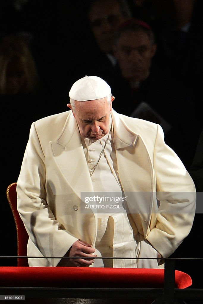 Pope Francis reacts during the Way of the Cross on Good Friday on March 29, 2013 at the Colosseum in Rome. Pope Francis presided over his first Good Friday which will culminate in a torch-lit procession at Rome's Colosseum and prayers for peace in a Middle East 'torn apart by injustice and conflicts'. AFP PHOTO / ALBERTO PIZZOLI