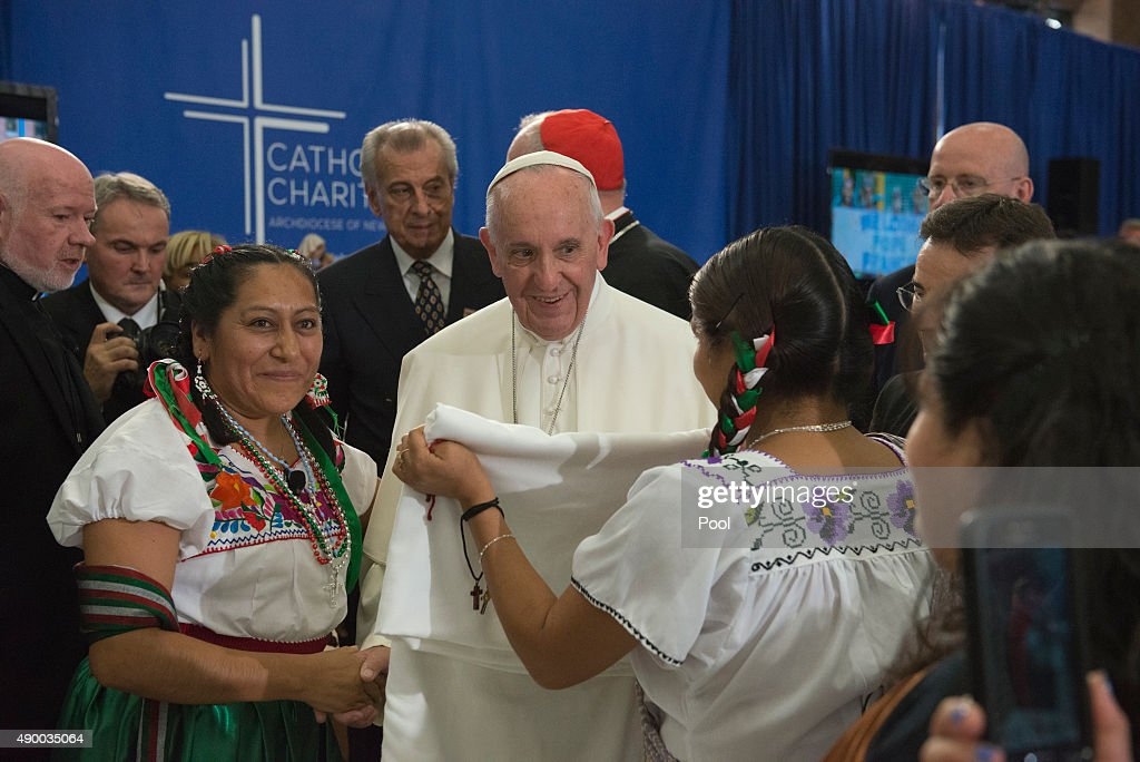 Pope Francis receives a gift inside Our Lady Queen of Angels School September 25, 2015 in the East Harlem neighborhood of New York City. Pope Francis is in New York on a two day visit and will carry out a number of engagements including a Papal motorcade through Central Park and a Mass in Madison Square Garden.