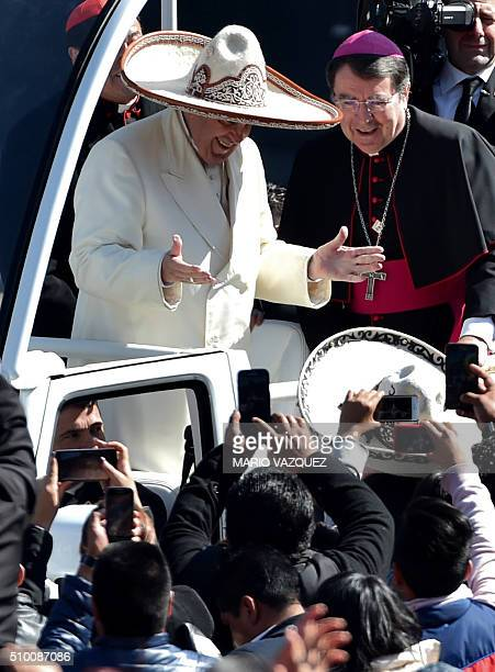 Pope Francis receives a traditional Mexican sombrero and greets people on his ride in the popemobile to the Zocalo in Mexico City on February 13 2016...
