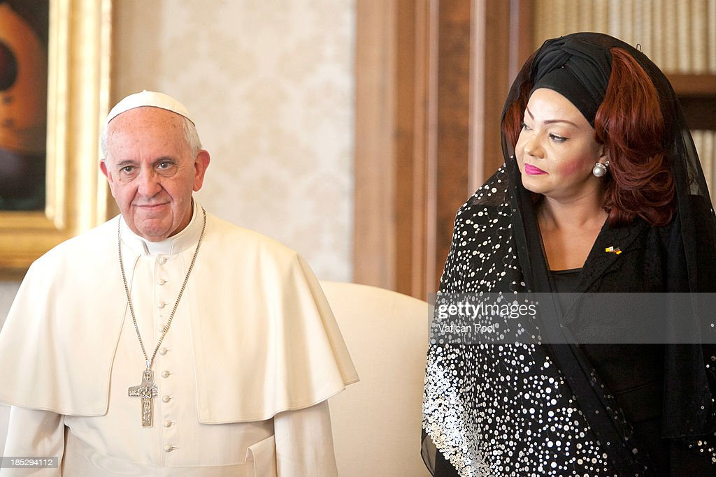 <a gi-track='captionPersonalityLinkClicked' href=/galleries/search?phrase=Pope+Francis&family=editorial&specificpeople=2499404 ng-click='$event.stopPropagation()'>Pope Francis</a> receives in audience Cameroon President Paul Biya and his wife <a gi-track='captionPersonalityLinkClicked' href=/galleries/search?phrase=Chantal+Biya&family=editorial&specificpeople=2564638 ng-click='$event.stopPropagation()'>Chantal Biya</a> at Vatican Apostolic Palace on October 18, 2013 in Vatican City, Vatican. During the colloquial discussions, satisfaction was expressed for good existing bilateral relations. Finally, attention was turned to various challenges relating to sub-Saharan Africa,emphasising Cameroon's commitment to security and peace in the Region.