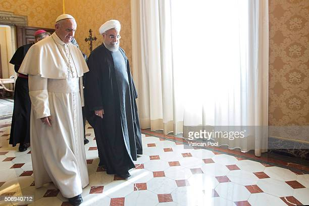 Pope Francis receives in audience with President of Iran Hassan Rouhani at his private library in the Apostolic Palace on January 26 2016 in Vatican...