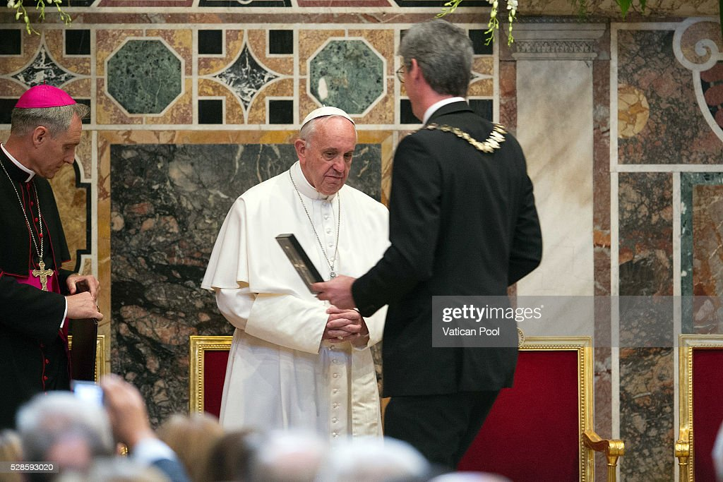 Pope Francis receives the Charlemagne Prize of Aachen from Marcel Philipp, Mayor of Aachen, at the Reggia Hall on May 6, 2016 in Vatican City, Vatican. The International Charlemagne Prize of Aachen is the oldest and best-known prize awarded for work done in the service of European unification.
