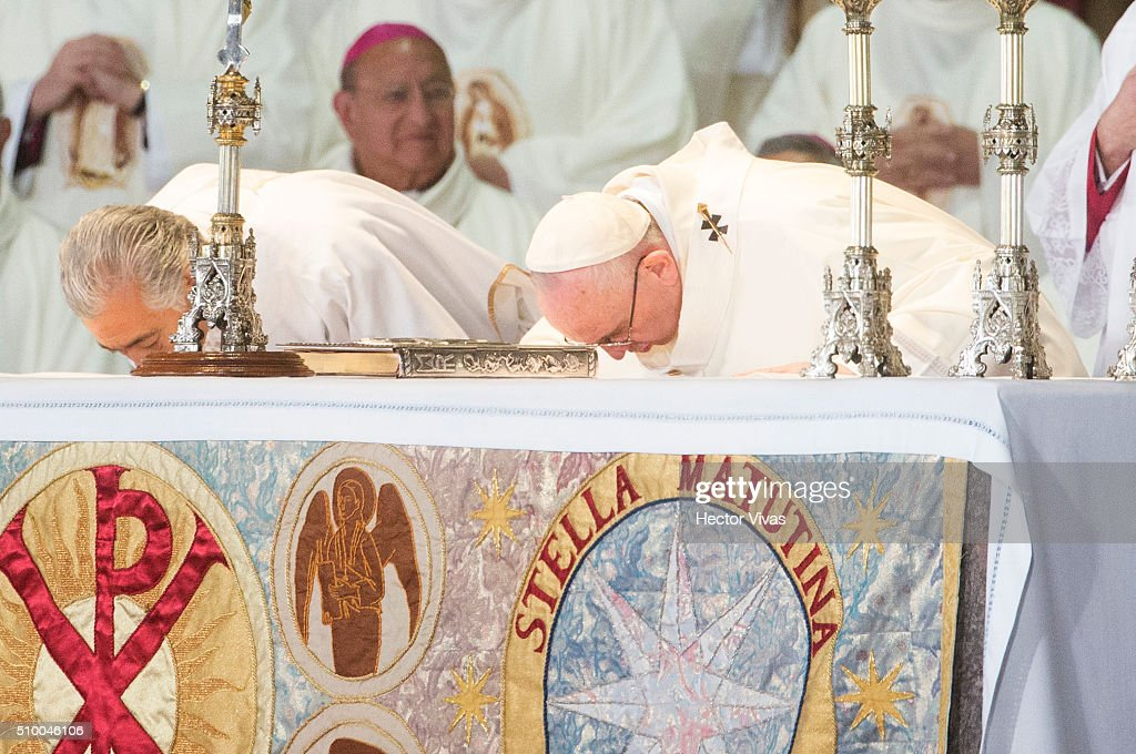 Pope Francis reverences during a mass for the people at Basilica de Guadalupe on February 13, 2016 in Mexico City, Mexico. Pope Francis is on a five days visit in Mexico from February 12 to 17 where he is expected to visit five states.