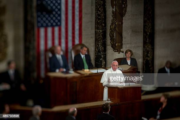 Pope Francis right speaks to a joint meeting of Congress in the House Chamber at the US Capitol with US Vice President Joseph 'Joe' Biden left and US...