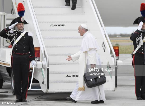 Pope Francis salutes honor guards before to board a plane to Egypt on April 28 2017 at Rome's Fiumicino airport Pope Francis heads for a twoday visit...