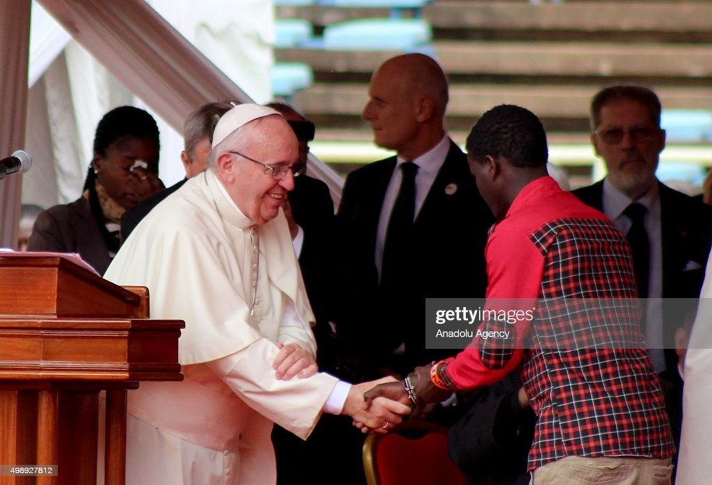 Pope Francis shakes hand with a Kenyan man during a meeting at the Kasarani stadium in Nairobi, Kenya on November 27, 2015.