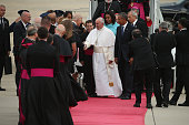 Pope Francis shakes hands with Vice President Joe Biden along with US President Barack Obama first lady Michelle Obama and other political and...