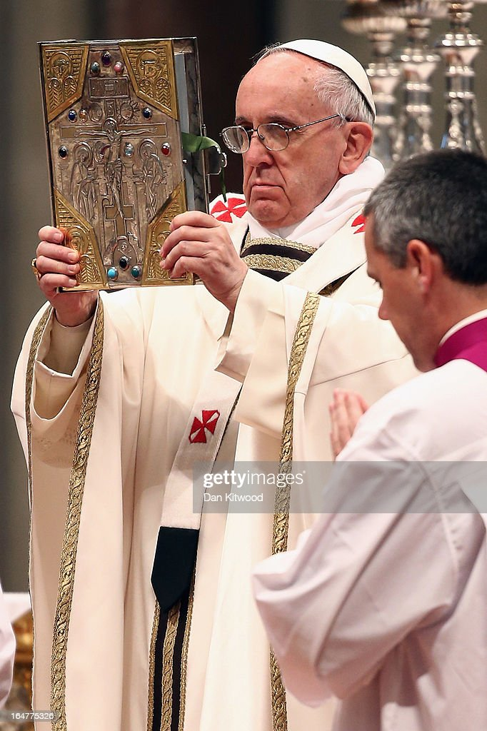 <a gi-track='captionPersonalityLinkClicked' href=/galleries/search?phrase=Pope+Francis&family=editorial&specificpeople=2499404 ng-click='$event.stopPropagation()'>Pope Francis</a> shows the gospel as he conducts his first Chrism Mass inside St Peter's Basilica on the morning of Holy Thursday on March 28, 2013 in Vatican City, Vatican. Newly-appointed <a gi-track='captionPersonalityLinkClicked' href=/galleries/search?phrase=Pope+Francis&family=editorial&specificpeople=2499404 ng-click='$event.stopPropagation()'>Pope Francis</a> has begun the Christian traditions leading up to Easter during his first holy week as pontiff. <a gi-track='captionPersonalityLinkClicked' href=/galleries/search?phrase=Pope+Francis&family=editorial&specificpeople=2499404 ng-click='$event.stopPropagation()'>Pope Francis</a> will today hold a feet-washing mass, which commemorates the last supper, at a youth detention centre where he will wash the feet of prisoners.