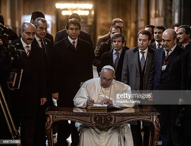 Pope Francis signs guest book during his visit to the Hagia Sophia on the second day of his threeday Turkey visit on November 29 2014 in Istanbul