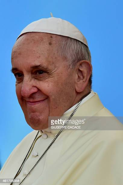 Pope Francis smiles during his visit to the University of Santo Tomas in Manila on January 18 2015 Pope Francis later celebrated mass with millions...