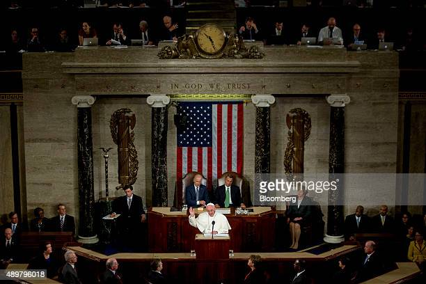 Pope Francis smiles while speaking to a joint meeting of Congress in the House Chamber at the US Capitol with US Vice President Joseph 'Joe' Biden...