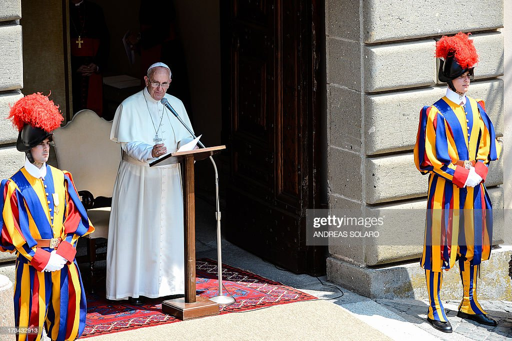 Pope Francis speaks on July 14, 2013 during his first Angelus prayer in front of his summer residence in Castel Gandolfo, 40 kms southeast of Rome. AFP PHOTO / ANDREAS SOLARO