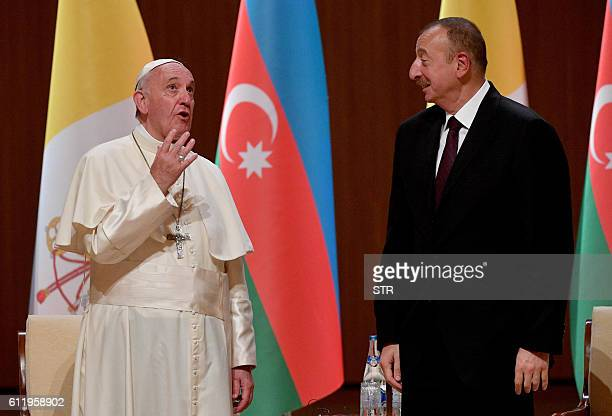 Pope Francis speaks with Azerbaijan's President Ilham Aliyev at the Aliyev congress center during a meeting with the authorities in Baku Azerbaijan...