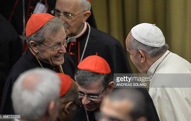 Pope Francis speaks with German Cardinal Walter Casper before the Synod on the Families to cardinals and bishops gathering in the Synod Aula at the...