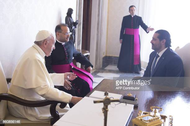 Pope Francis speaks with Prime Minister of Lebanon Saad Hariri during a private audience at the Vatican on October 13 2017 / AFP PHOTO / POOL /...