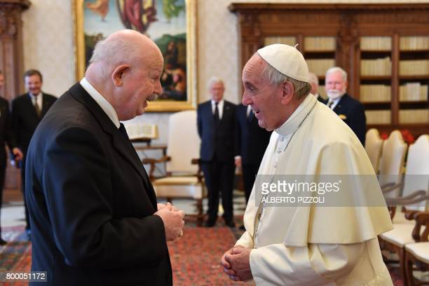 Pope Francis speaks with the Grand Master of the Sovereign Military Order of Malta Giacomo Dalla Torre del Tempio di Sanguinetto during a private...