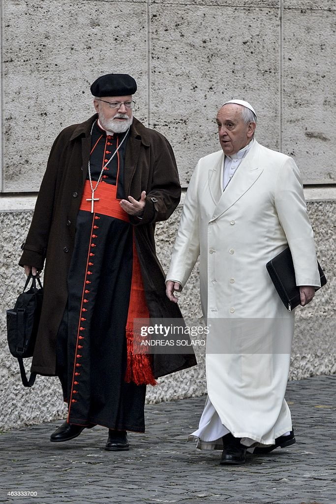 Pope Francis (R) speaks with US Cardinal <a gi-track='captionPersonalityLinkClicked' href=/galleries/search?phrase=Sean+Patrick+O%27Malley&family=editorial&specificpeople=729476 ng-click='$event.stopPropagation()'>Sean Patrick O'Malley</a> as he arrives to take part with cardinals and bishops in the Papal consistory before the nominations of new cardinals, at the Vatican on February 13, 2015. AFP PHOTO / ANDREAS SOLARO