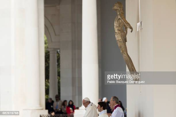 Pope Francis stands in front of a figure representing Jesus Christ during a ceremony of canonization at the Sanctuary of Fatima on May 13 2017 in...