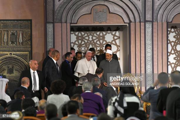 Pope Francis stands next to Sheikh Ahmed alTayeb the Grand Imam of AlAzhar during a visit to the prestigious Sunni institution in Cairo on April 28...