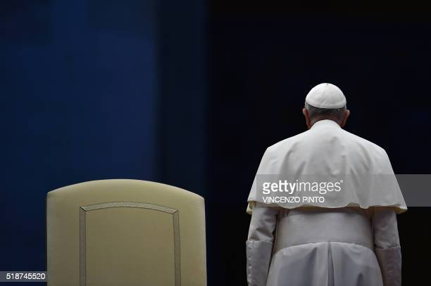 TOPSHOT Pope Francis stands up at the end of a prayer vigil on the occasion of the Jubilee of Divine Mercy at St Peter's square on April 2 2016 in...
