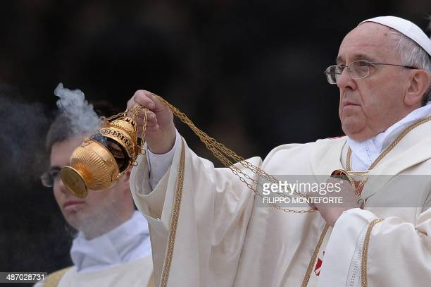 Pope Francis swings the censer during the canonisation mass of Popes John XXIII and John Paul II on St Peter's at the Vatican on April 27 2014...