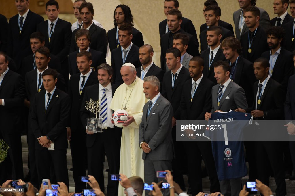 Pope Francis takes a family photo with the players of the 'Partita Interreligiosa Della Pace' at Paul VI Hall on September 1 2014 in Vatican City...