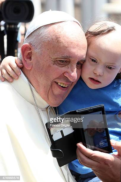 Pope Francis takes a selfie with a child during an audience with Scouts in St Peter's Square on June 13 2015 in Vatican City Vatican Pontiff met this...
