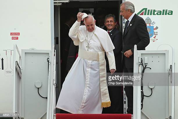 Pope Francis takes off his cap while stepping off an airplane after arriving from Cuba September 22 2015 at Joint Base Andrews Maryland Francis will...