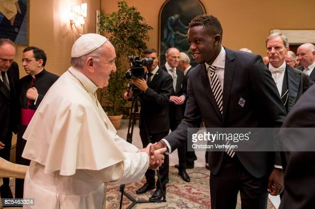 Pope Francis talks to Denis Zakaria during a private audience with his team of Borussia Moenchengladbach in the Palace of the Vatican on August 02...
