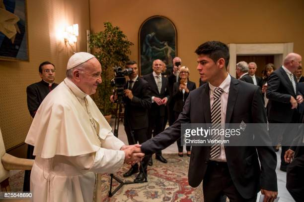 Pope Francis talks to Julio Villalba during a private audience with his team of Borussia Moenchengladbach in the Palace of the Vatican on August 02...