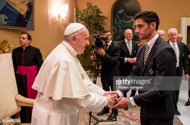 Pope Francis talks to Lars Stindl during a private audience with Borussia Moenchengladbach in the Palace of the Vatican on August 02 2017 in Vatican...