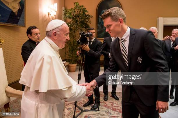 Pope Francis talks to Matthias Ginter during a private audience with Borussia Moenchengladbach in the Palace of the Vatican on August 02 2017 in...