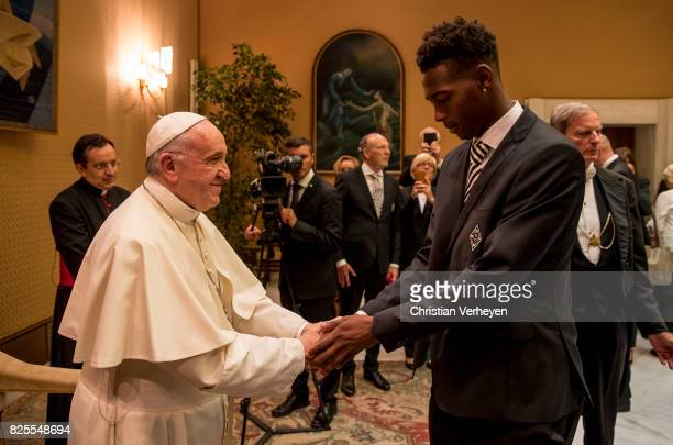 Pope Francis talks to Reece Oxford during a private audience with his team of Borussia Moenchengladbach in the Palace of the Vatican on August 02...